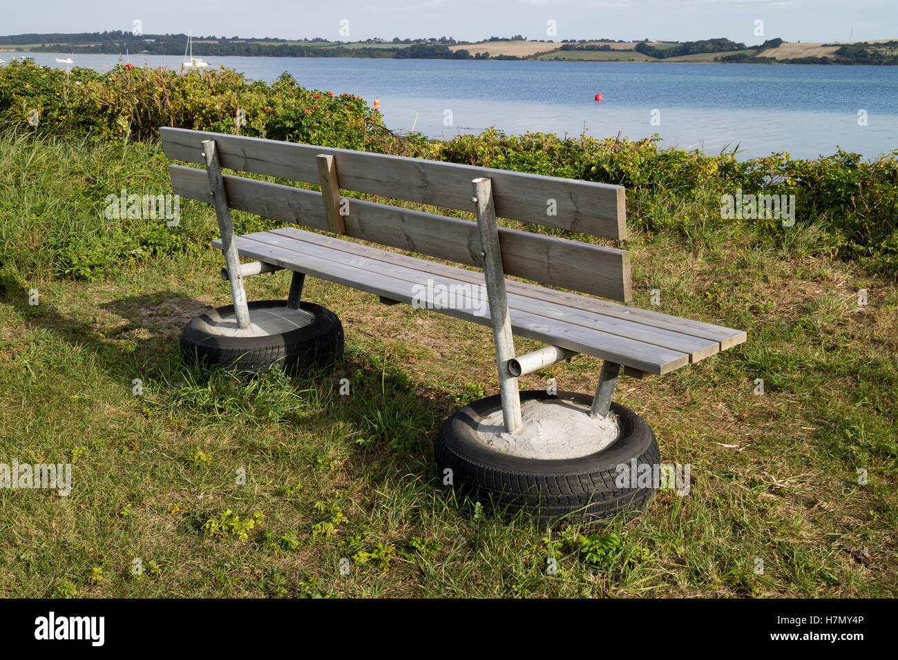 Bench on recycled tires in Broager near the sea, Denmark - Stock Image