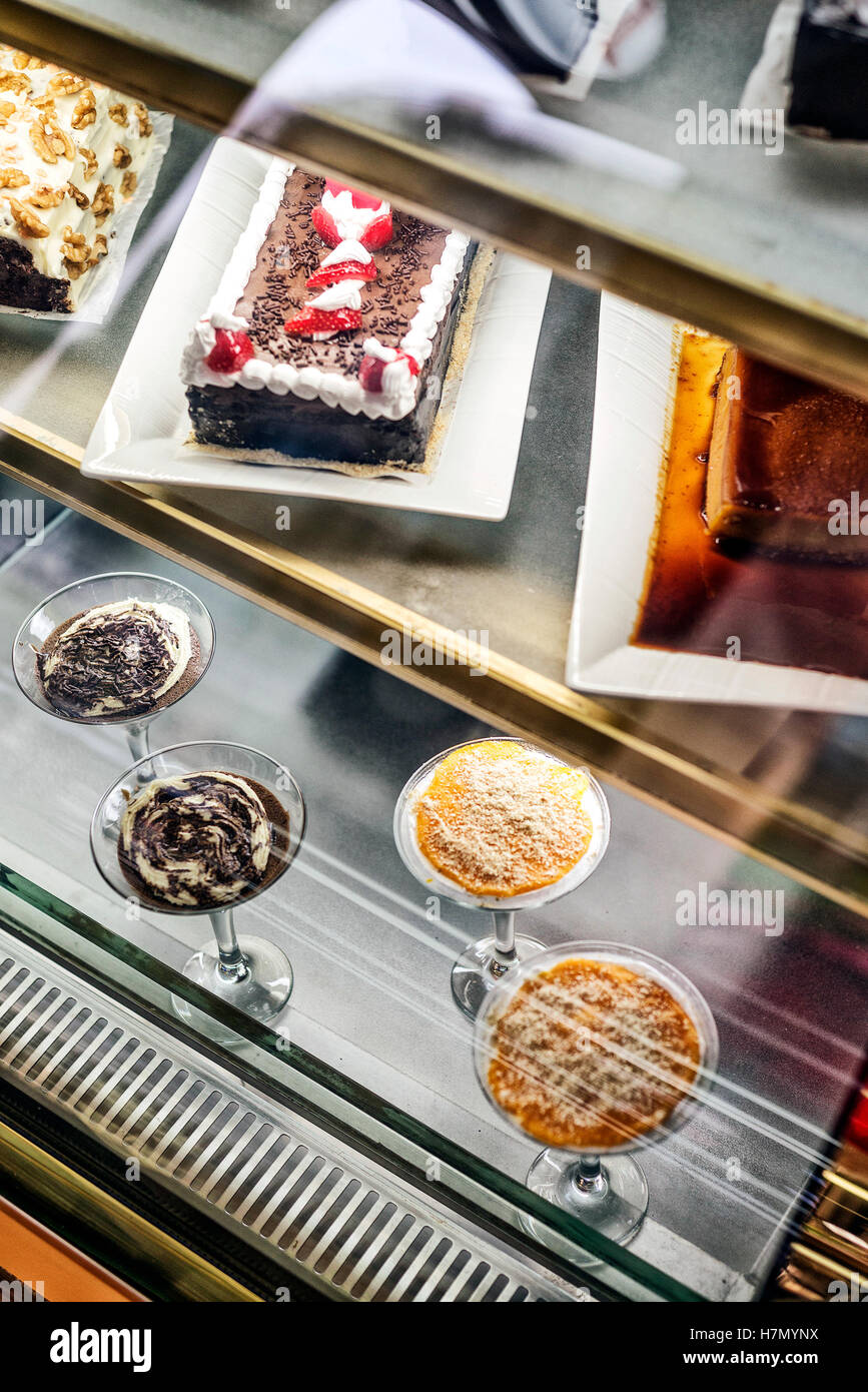 mixed portuguese traditional cakes and sweet desserts in cafe display portugal - Stock Image