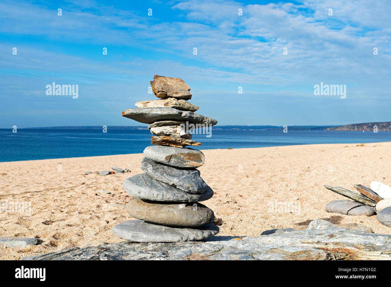 a stone tower on a beach in cornwall, uk - Stock Image