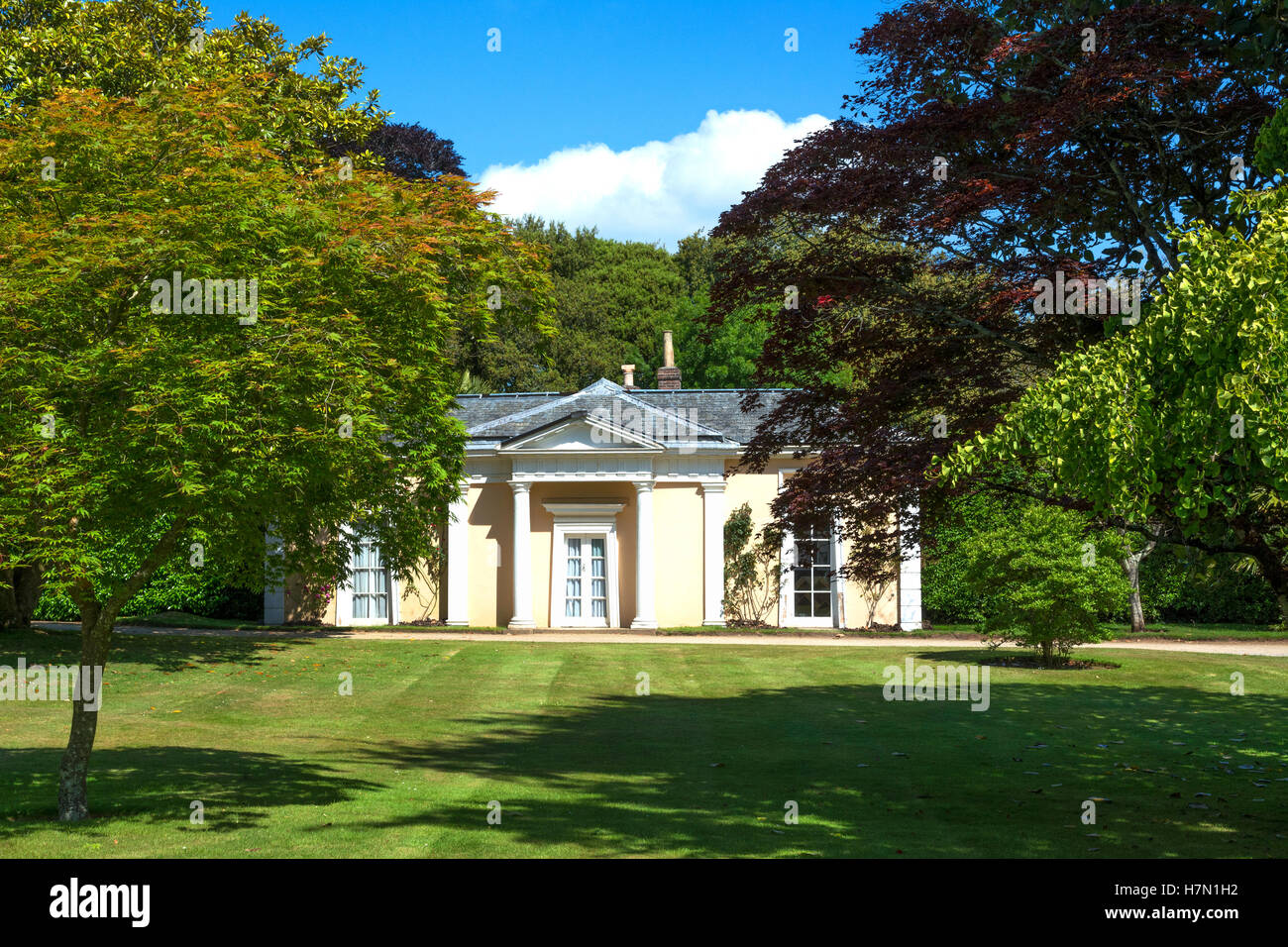 a summer house in the gardens at Mount Edgcumbe in Cornwall, England, UK - Stock Image