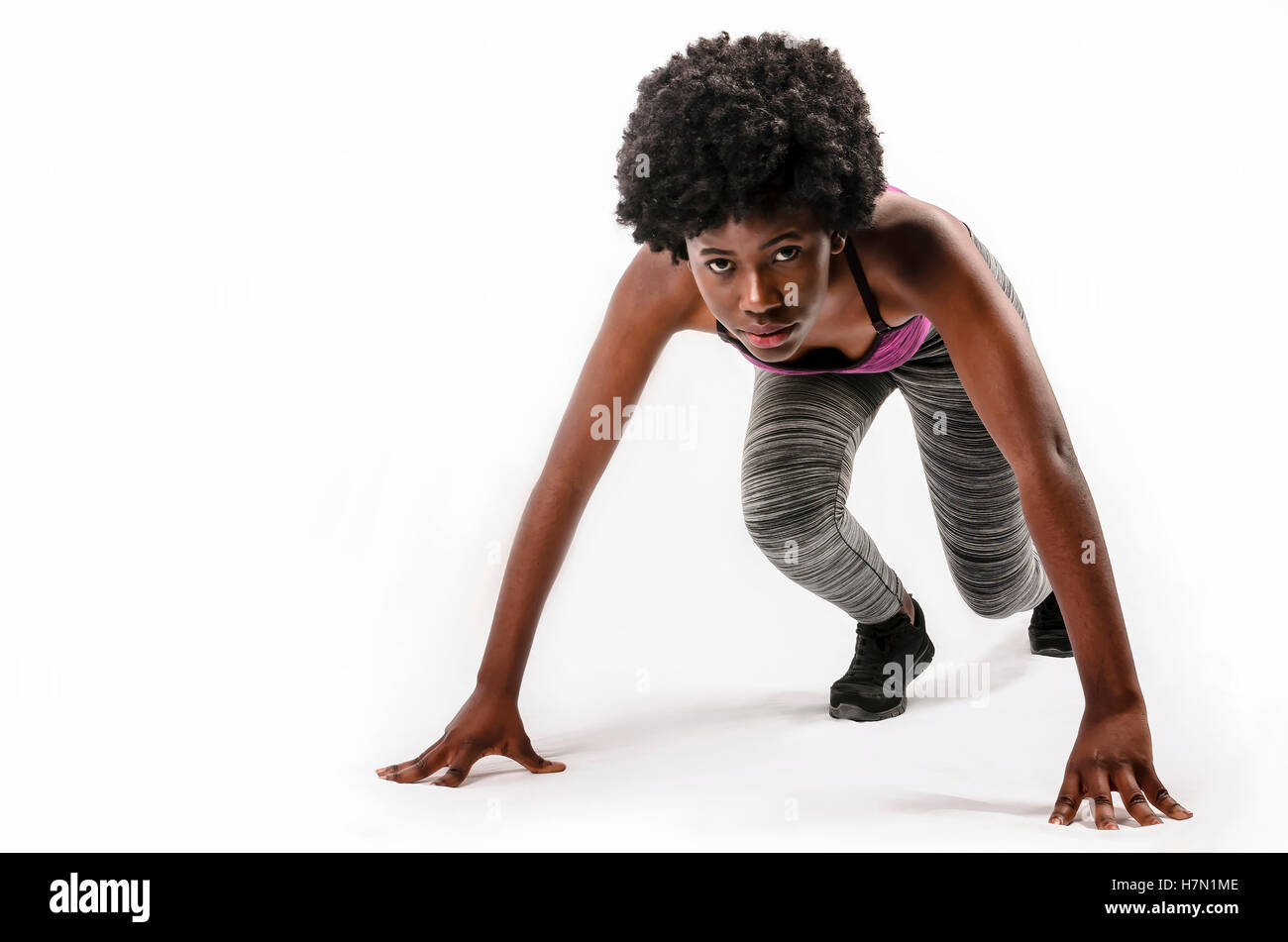 fit black woman set for a run over white background - Stock Image