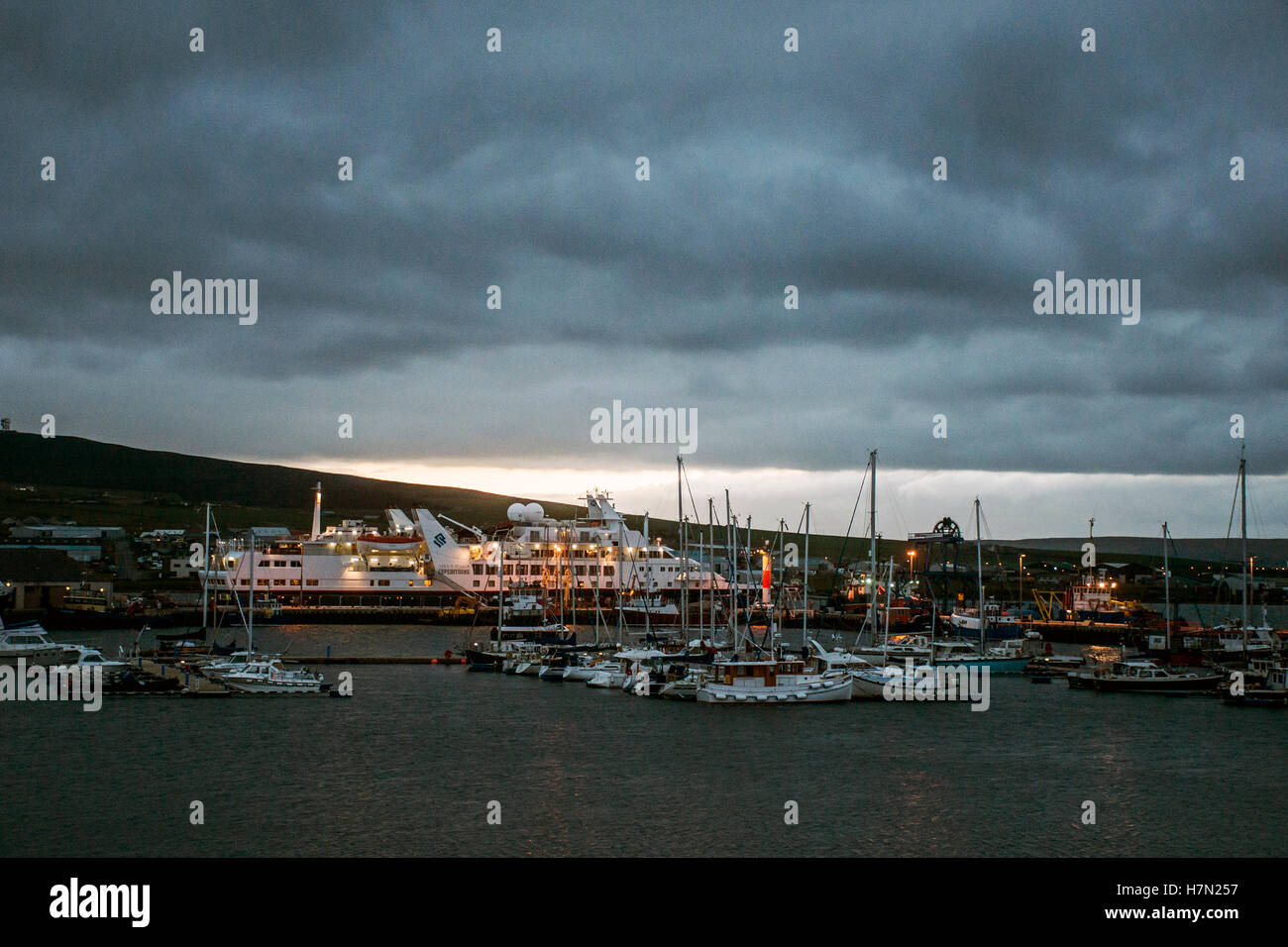 Ships Sunset Boat harbor in Kirkwall Orkney Islands Scotland United Kingdom 18.05.2016 - Stock Image