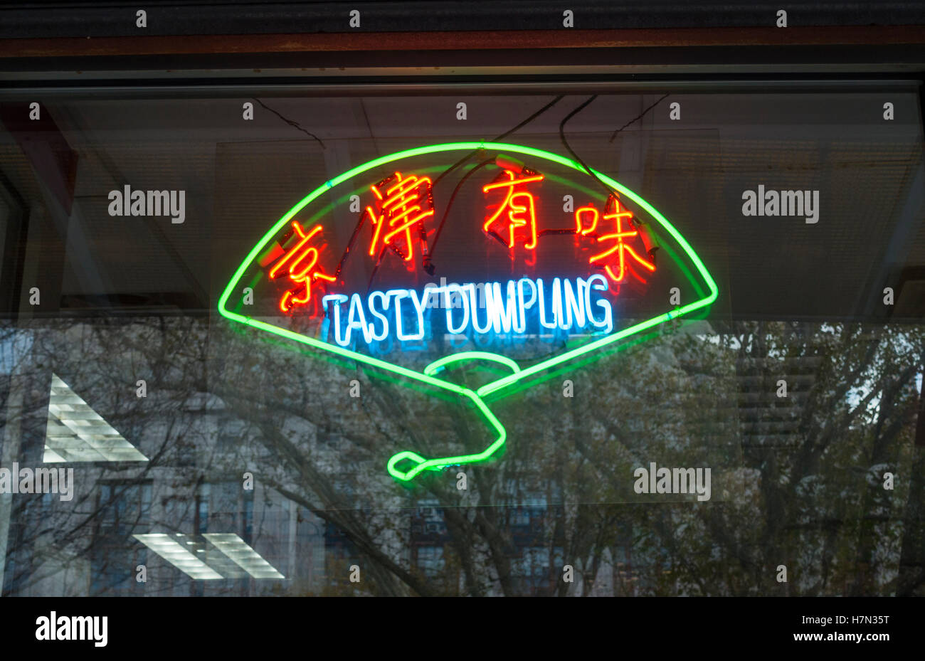 Neon sign in the window of Tasty Dumpling restaurant in Chinatown, New York City - Stock Image