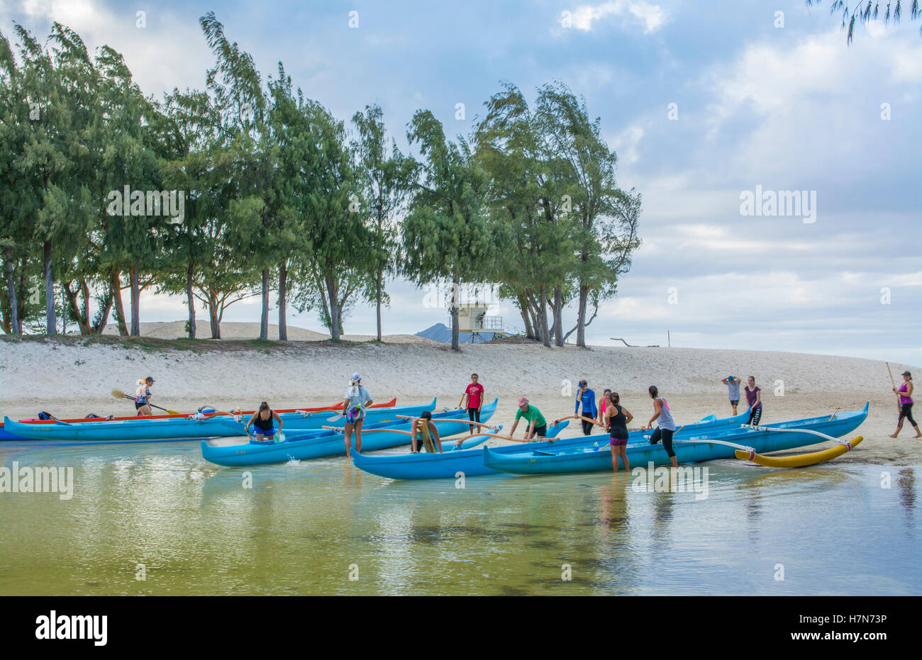 Kailua Hawaii Oahu canoe club rowing on Outrigger Canoes in bay practice sports athletics exerfcise - Stock Image