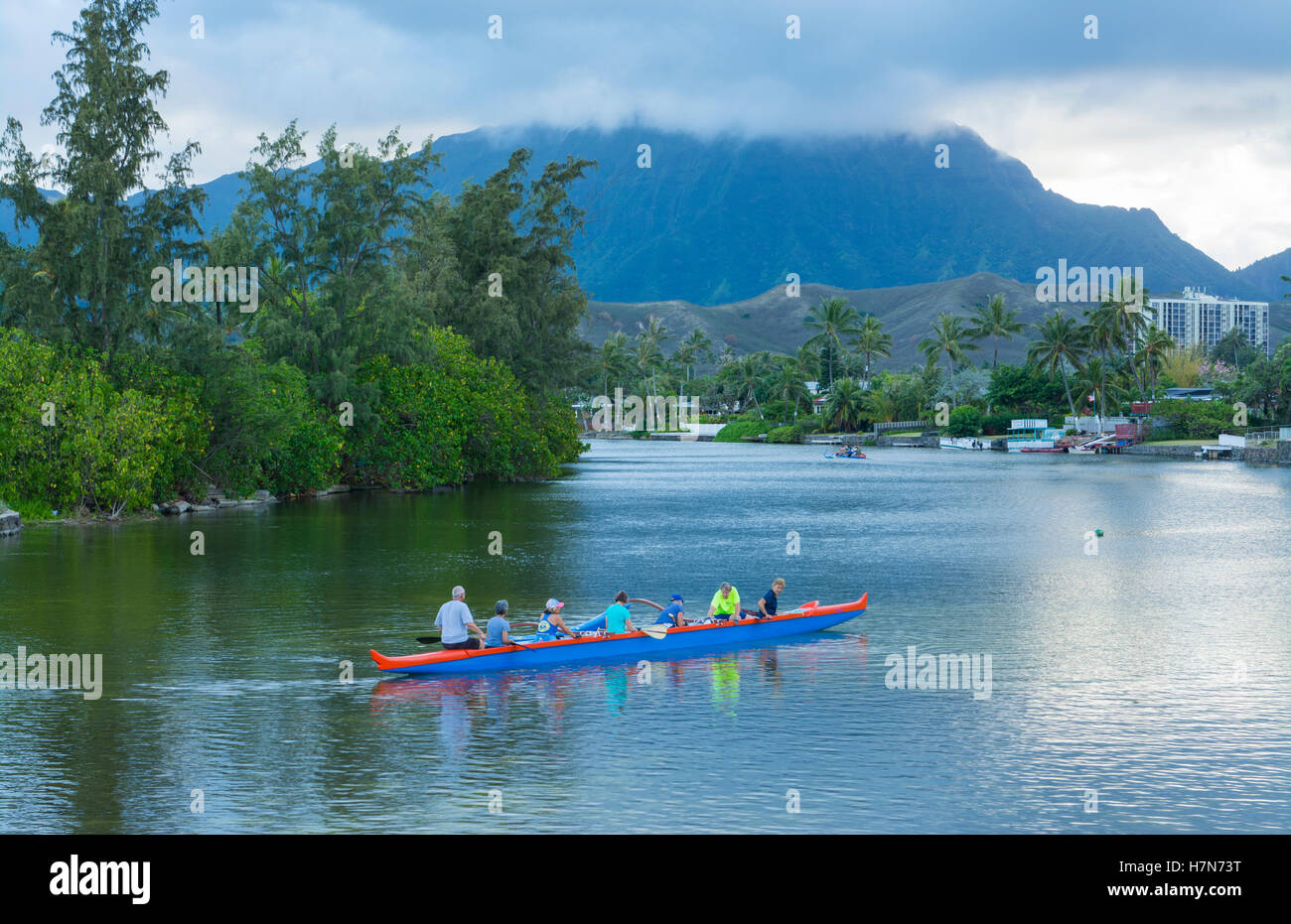 Kailua Hawaii Oahu canoe club rowing on Outrigger Canoes in bay practice sports athletics exercise - Stock Image
