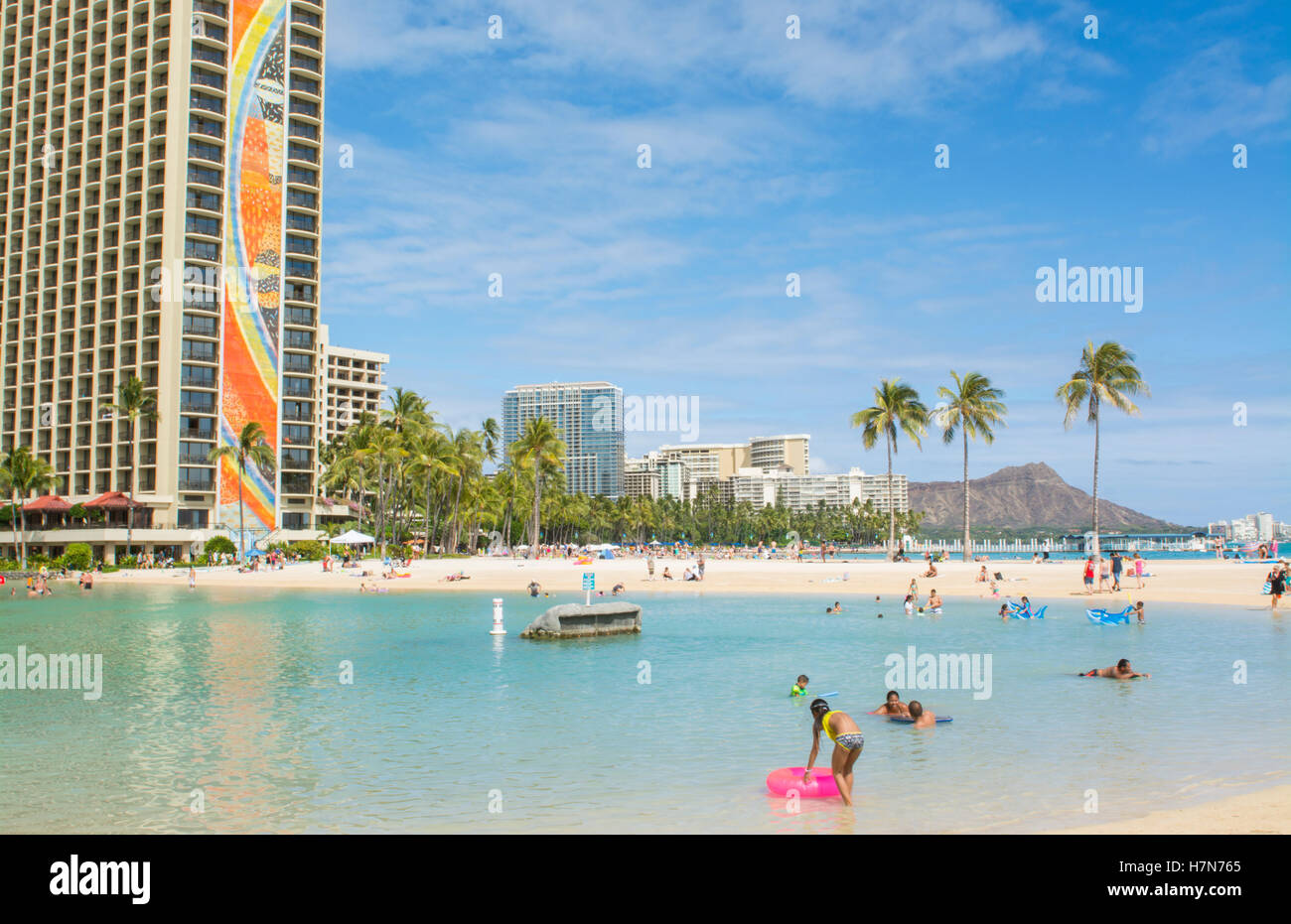Honolulu Hawaii Oahu famous Hilton Hawaiian Waikiki Beach Resort with Diamond Head in Distance with beach and ocean - Stock Image