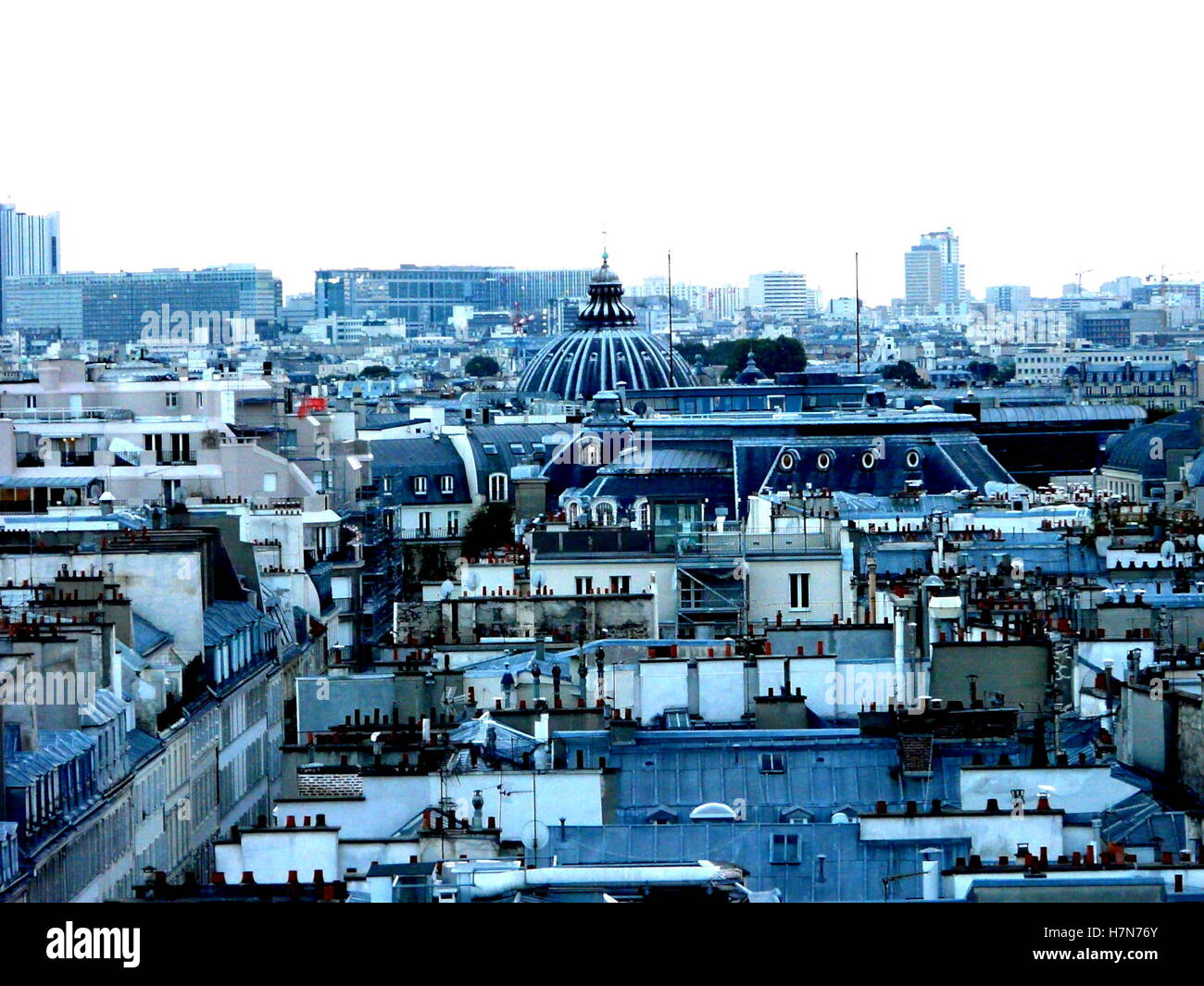 Paris cityscape with blue roofs and Grand Palais. White sky and blue buildings. - Stock Image
