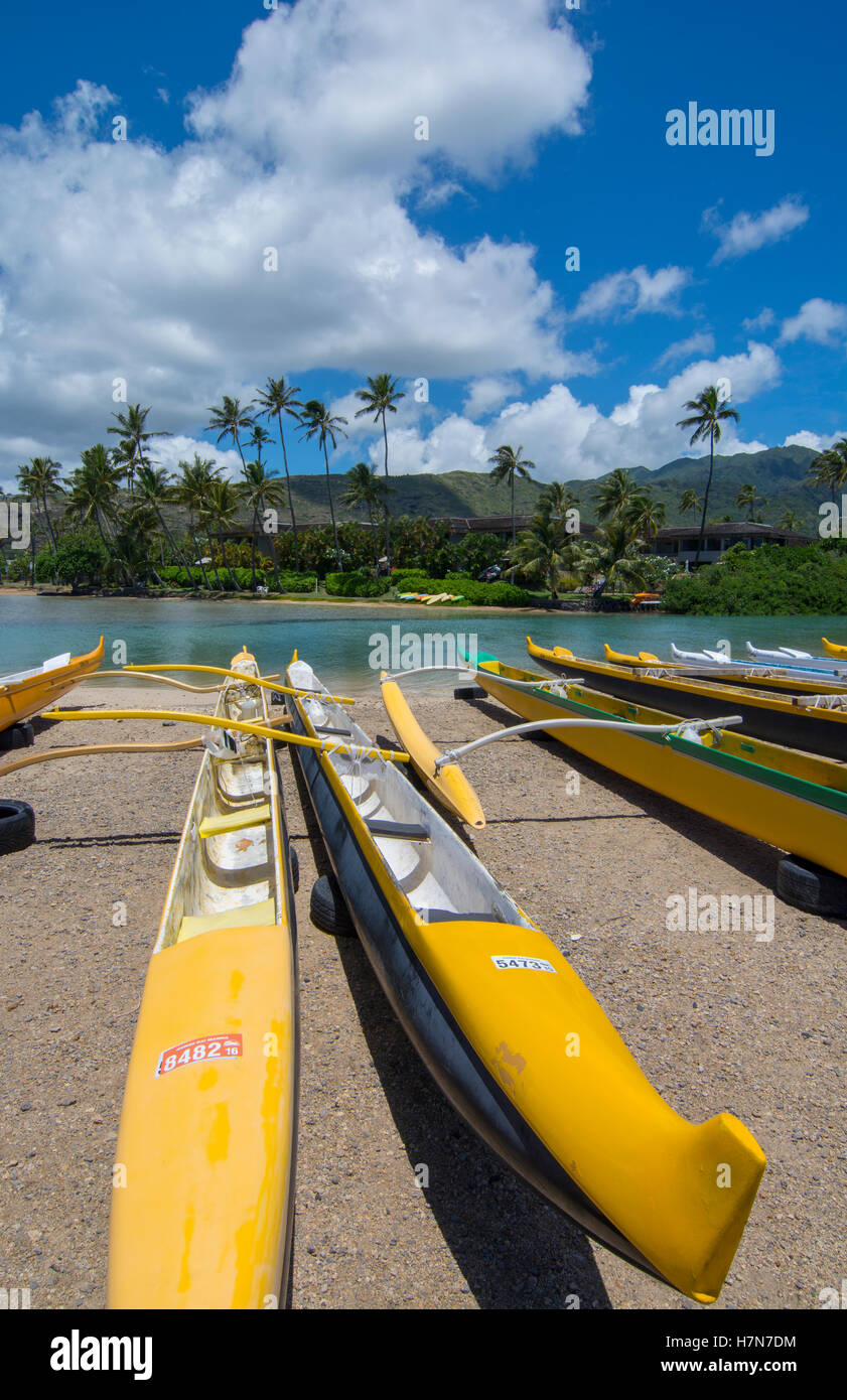 Honolulu Hawaii Oahu Outrigger canoes at Maunalua Bay in South Oahu yellow speed canoe - Stock Image