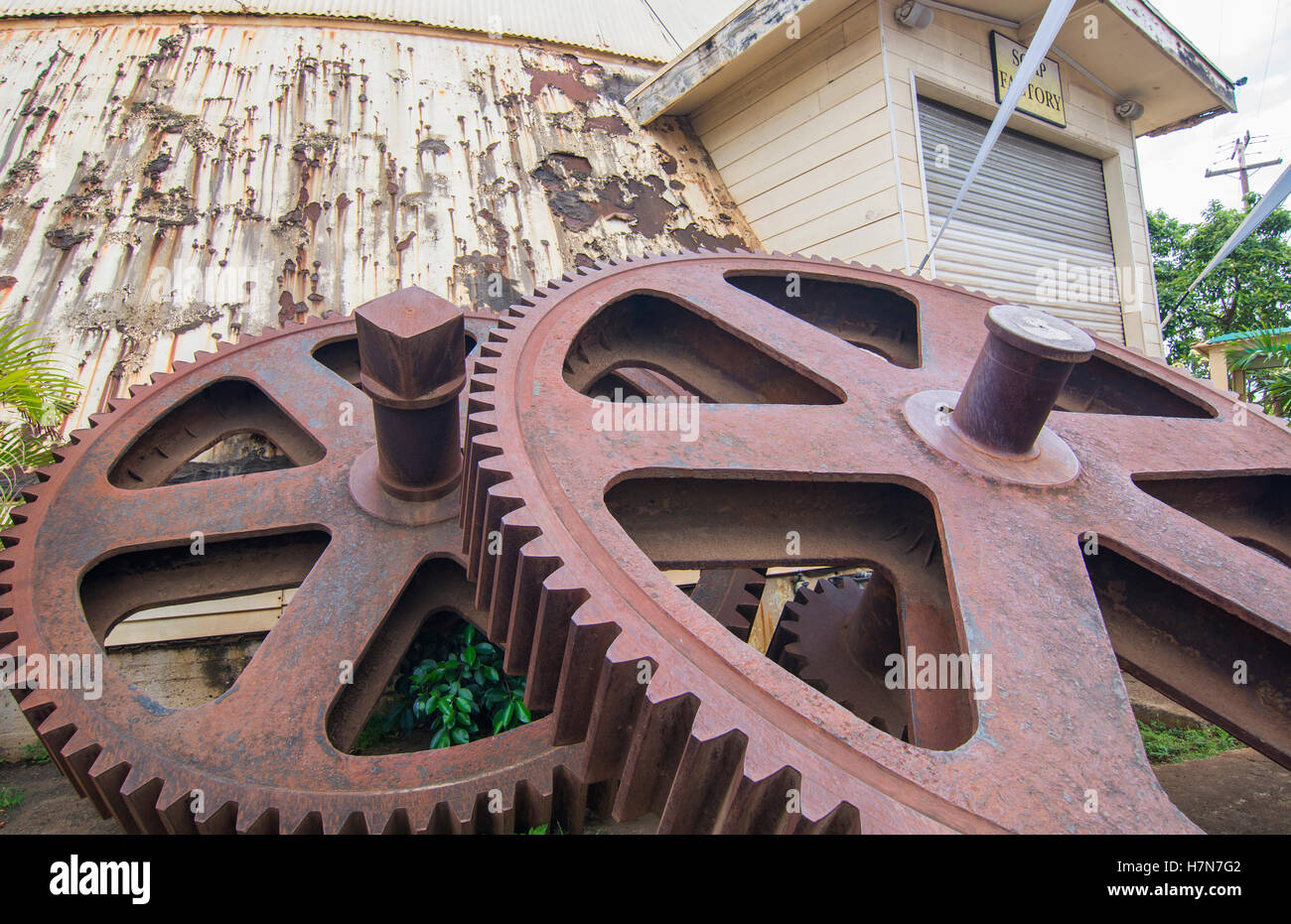 Waialua Hawaii Oahu old deserted sugar mill with giant gears deserted mill - Stock Image