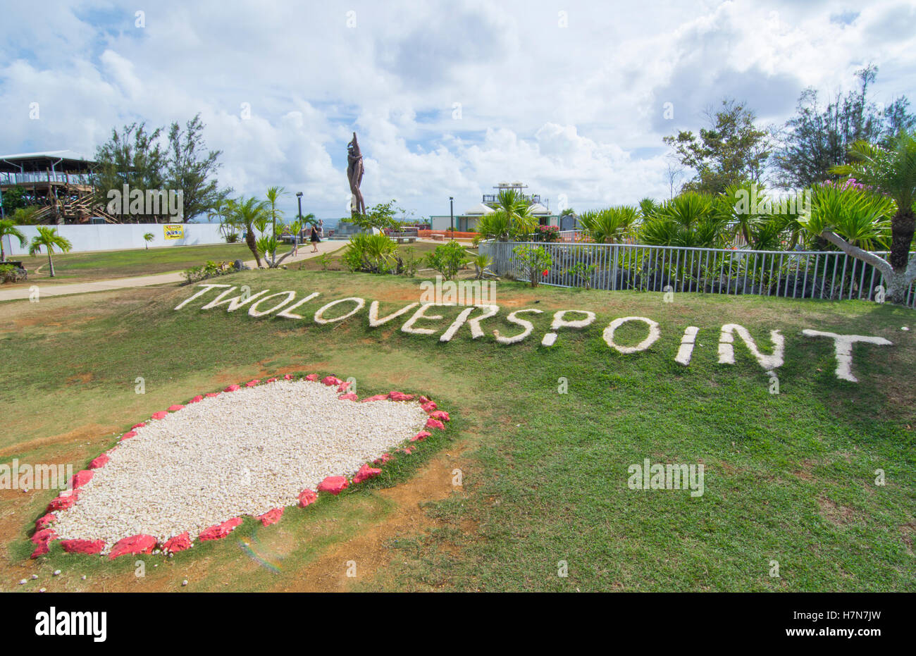 Guam USA Territory famous Two Lovers Point for tourists attraction sign with rocks - Stock Image