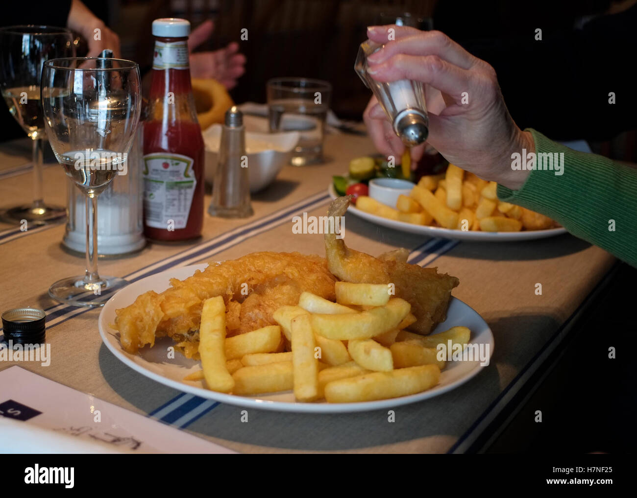 A plate of fish and chips is seen at lunchtime in a fish restaurant, in Hastings, Britain November 6, 2016.  © - Stock Image