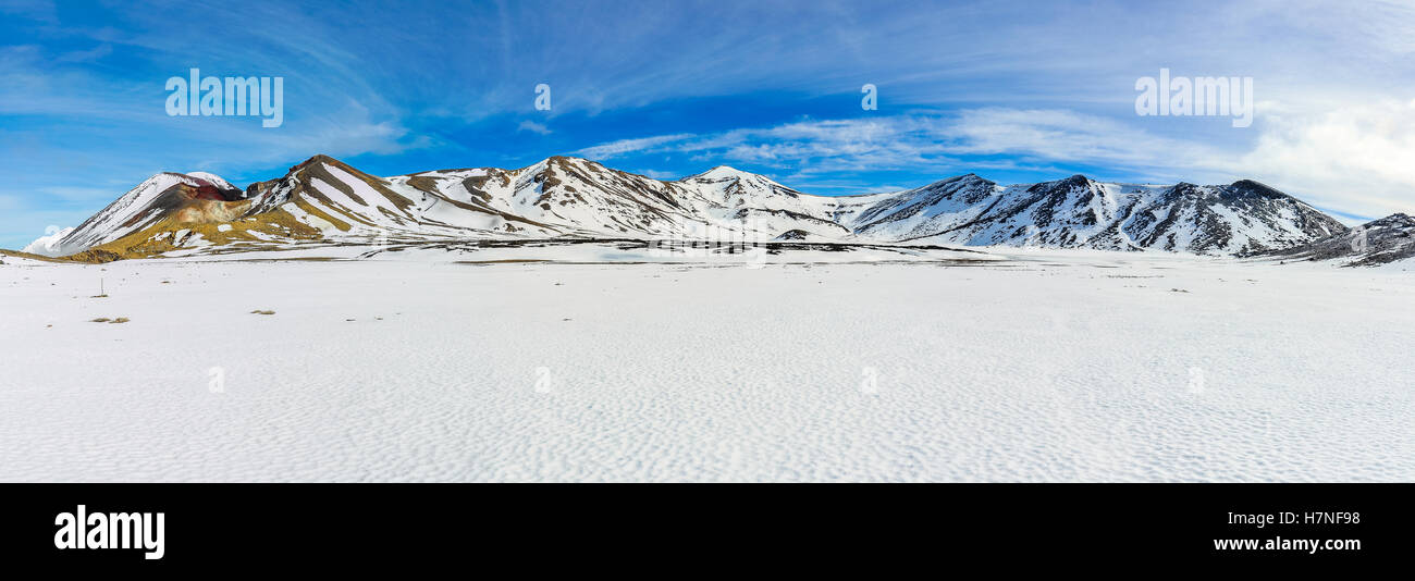 Snowy mountains of Central Crater in the winter Tongariro Alpine Crossing, New Zealand - Stock Image