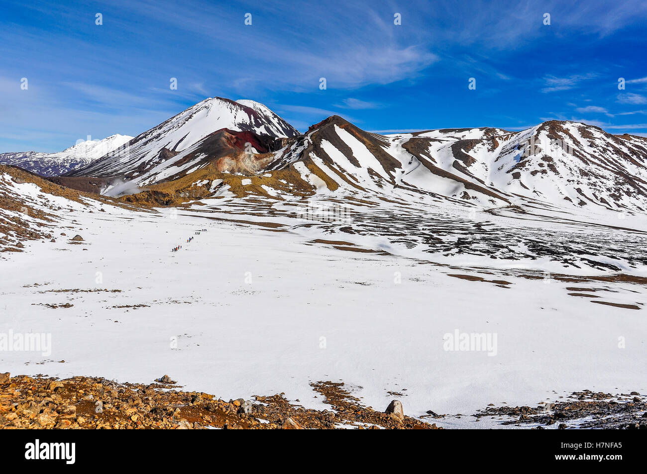 People crossing the Central Crater in the winter Tongariro Alpine Crossing, New Zealand - Stock Image