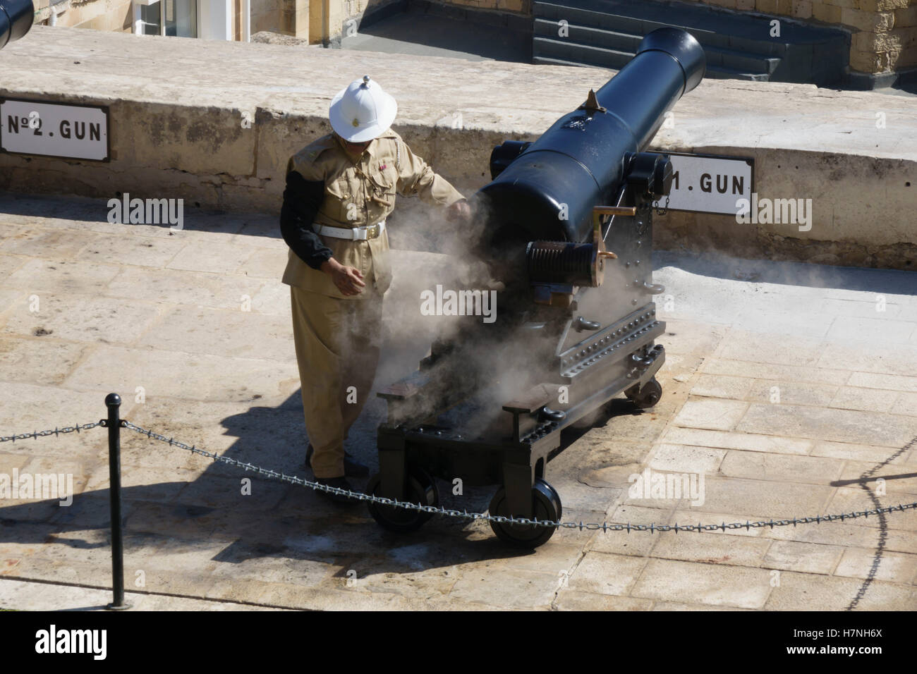 Valletta, walled capital city port of Malta. The twelve o'clock gun is fired from the Saluting Battery below - Stock Image