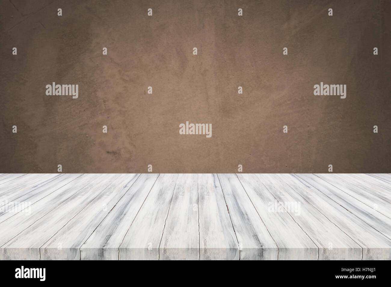 Empty white table top with concrete wall background For product