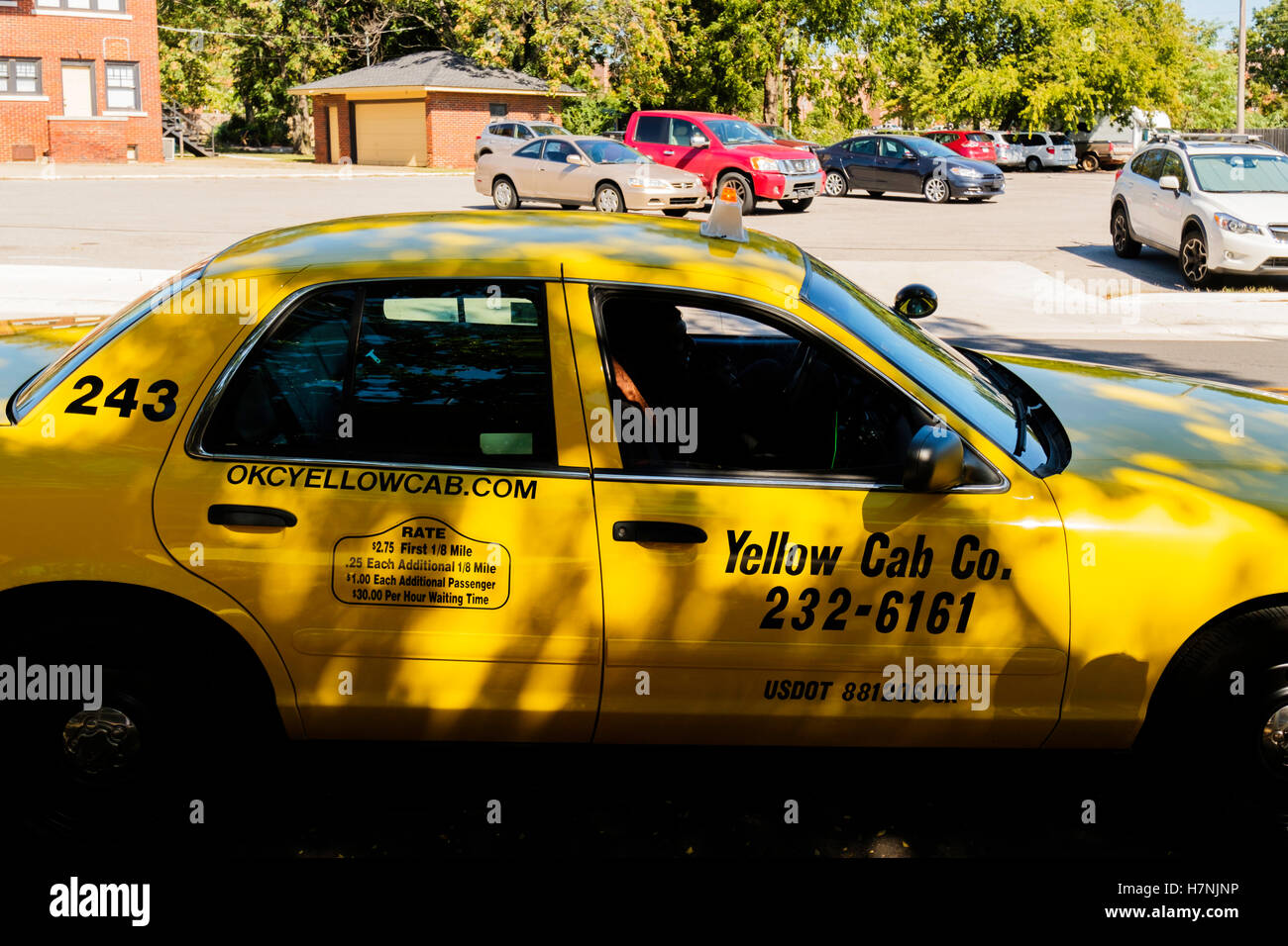 A taxi driver from Yellow Cab Co. waits for a fare in Oklahoma City, Oklahoma, USA. - Stock Image