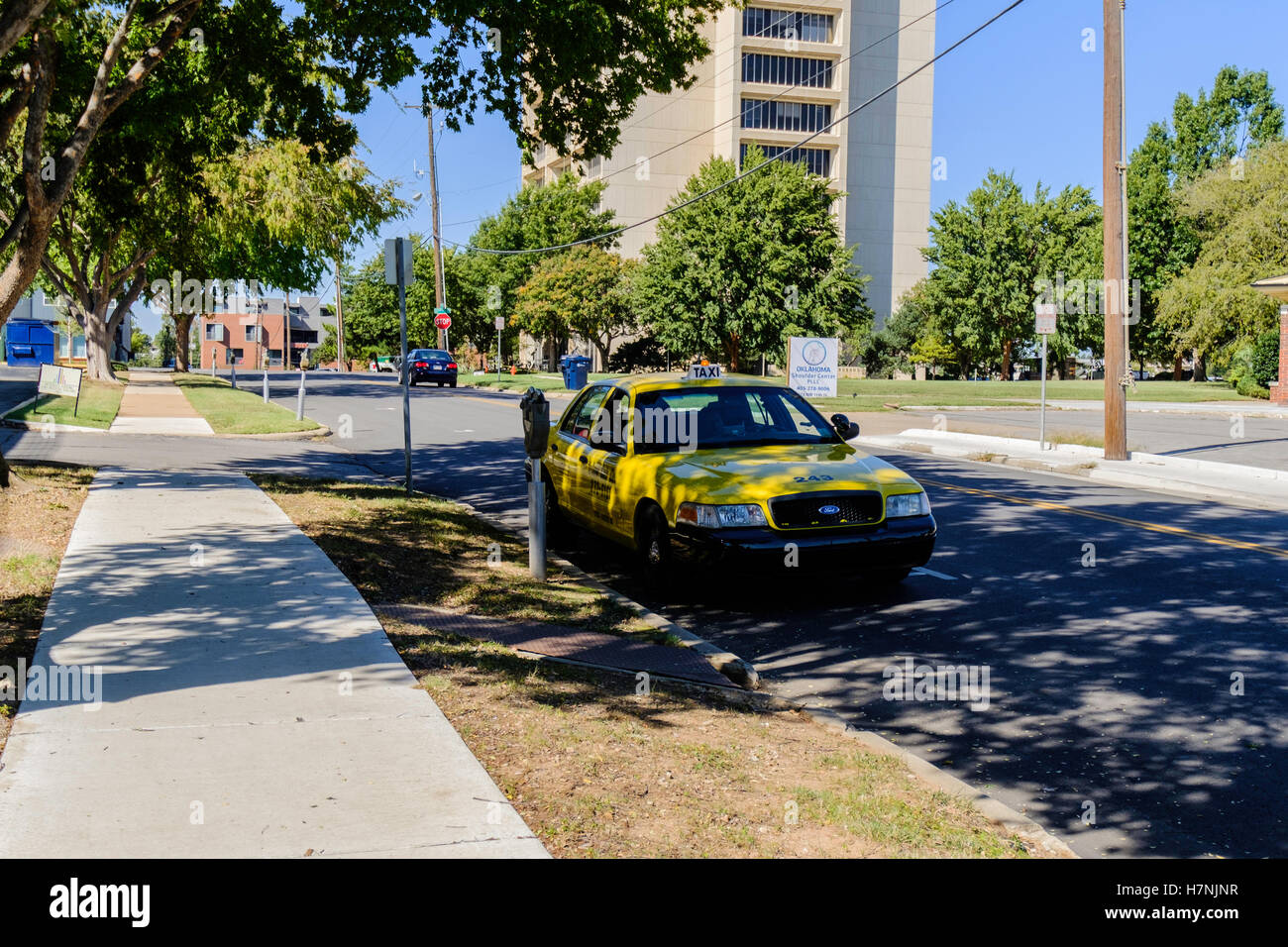 A taxi from Yellow Cab Co. waits for a fare in Oklahoma City, Oklahoma, USA. - Stock Image