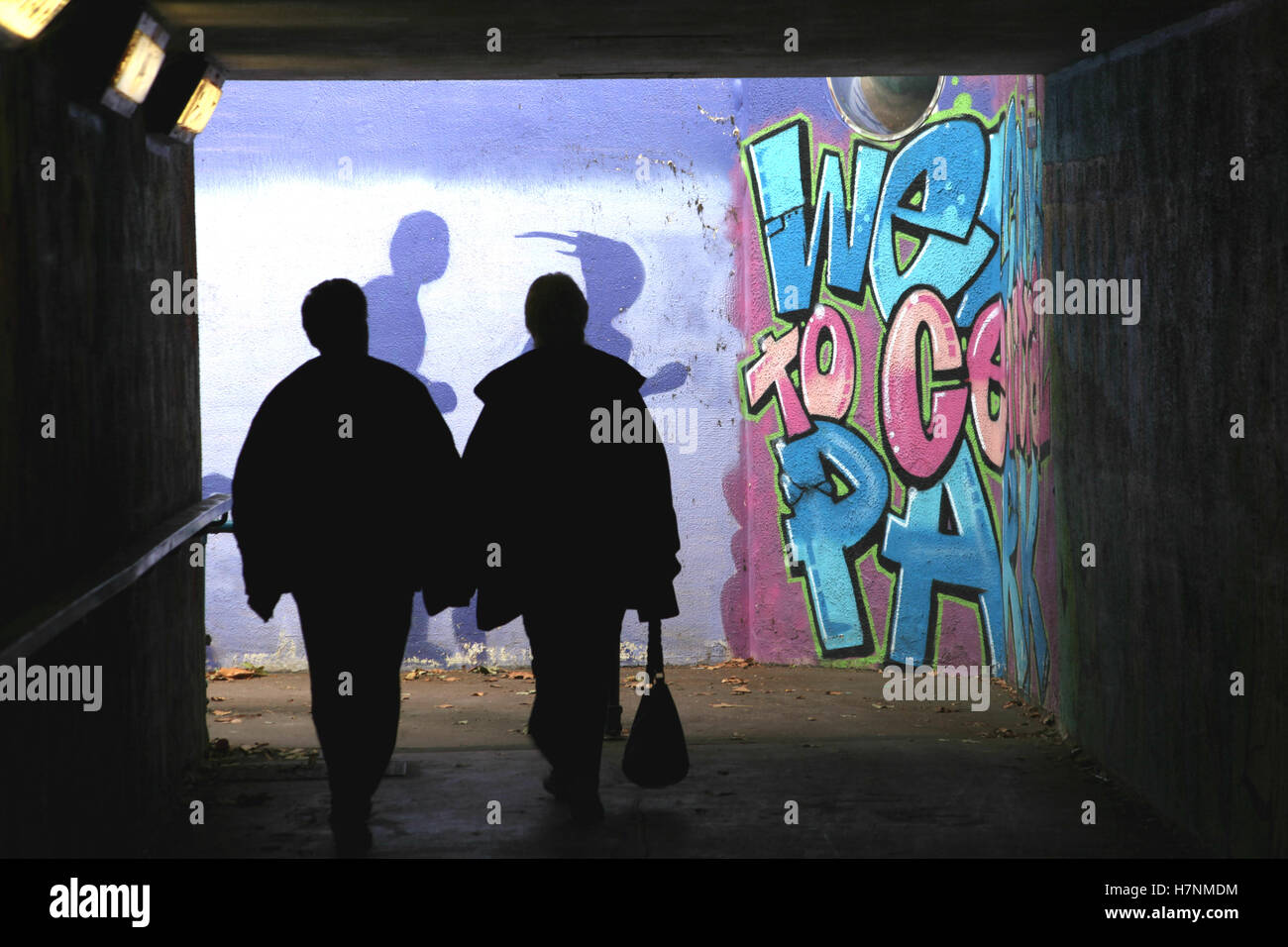 Two people exit an underpass from Central Park, Chelmsford, Essex - Stock Image