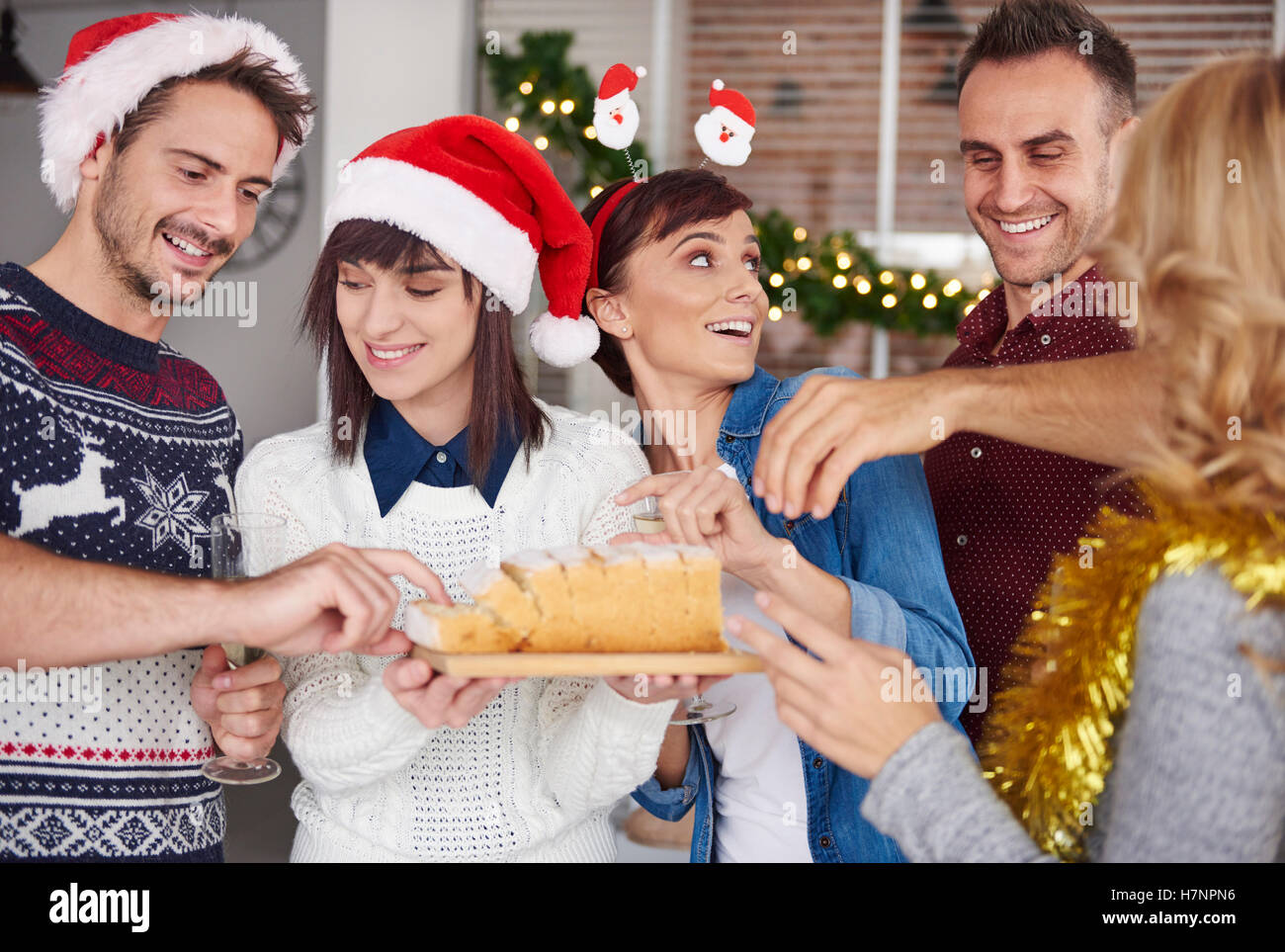 Take and try a piece of Christmas cake - Stock Image