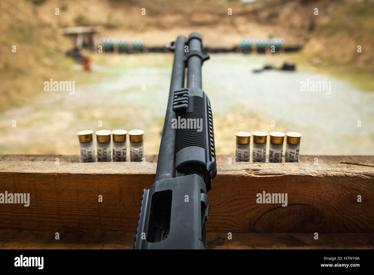 Pump gun. Close up of the pump-action rifle of 12 caliber with the targets on background. shooting, shooting on - Stock Image