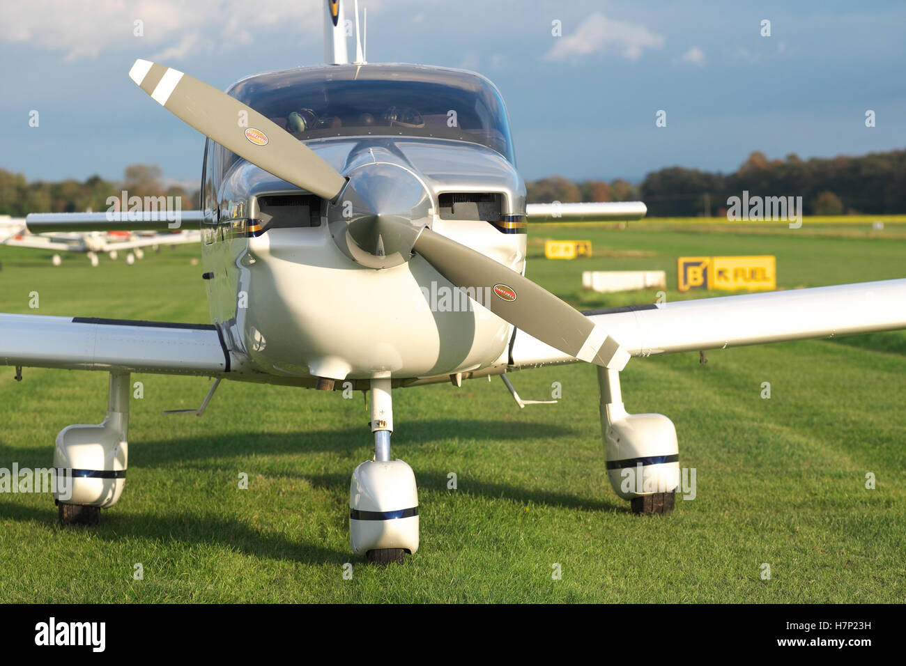 Light aircraft a single engine Socata TB-10 Tobago plane parked at a grass airfield aerodrome in the UK - Stock Image