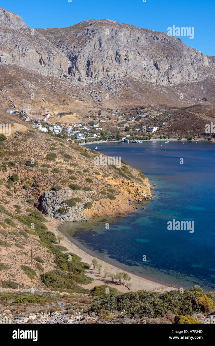 Beach blue sea and mountains, Emborios Bay, Kalymnos - Stock Image
