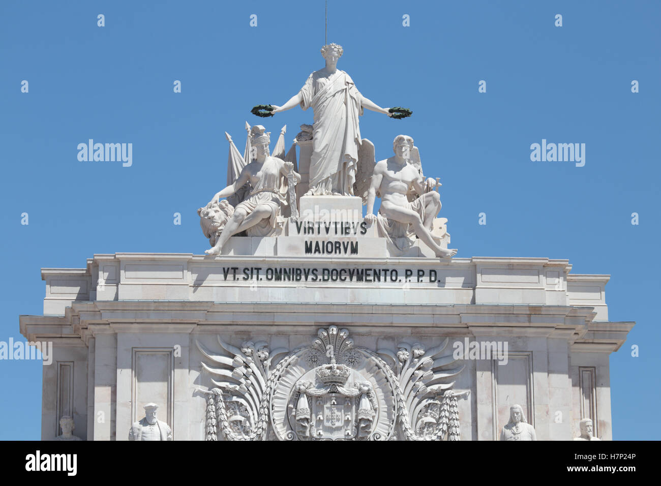 Statues at the top of Rua Augusta Arch in Lisbon, Portugal. Allegory of Glory rewarding Valor and Genius. - Stock Image