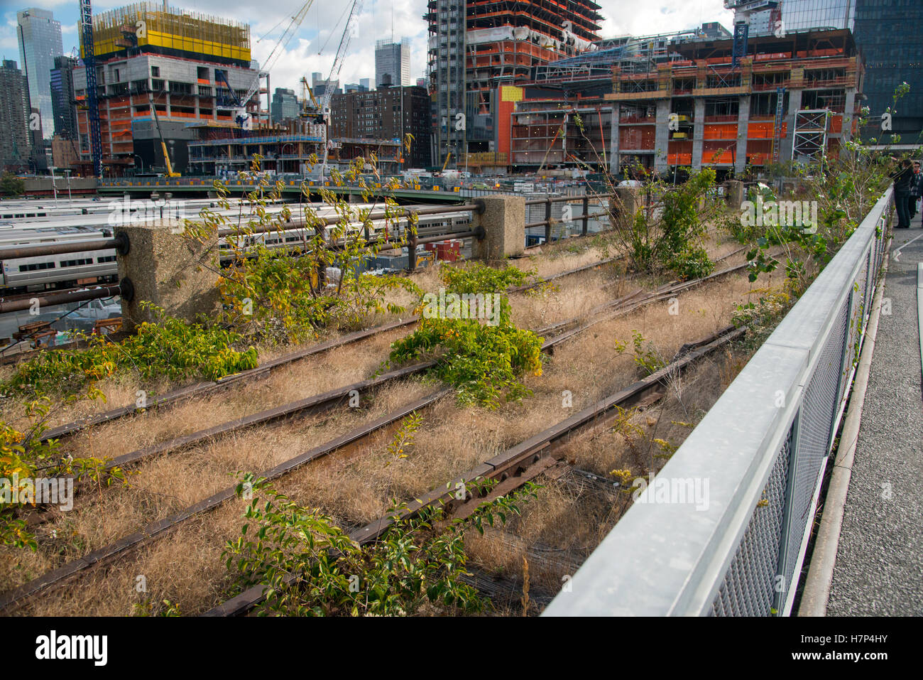 Disused train lines on the raised railway, now the Highline park, overlooking MTA metro train yards near the Hudson - Stock Image
