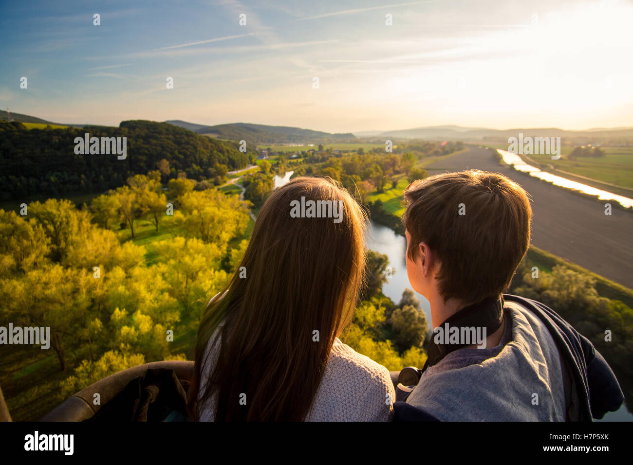 Couple enjoying view from hot air baloon - Stock Image