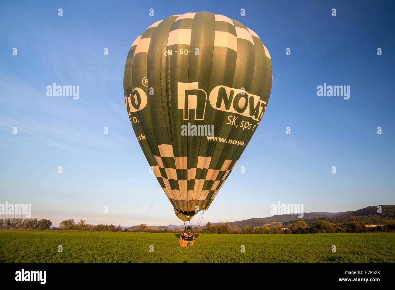 Hot air baloon taking off - Stock Image