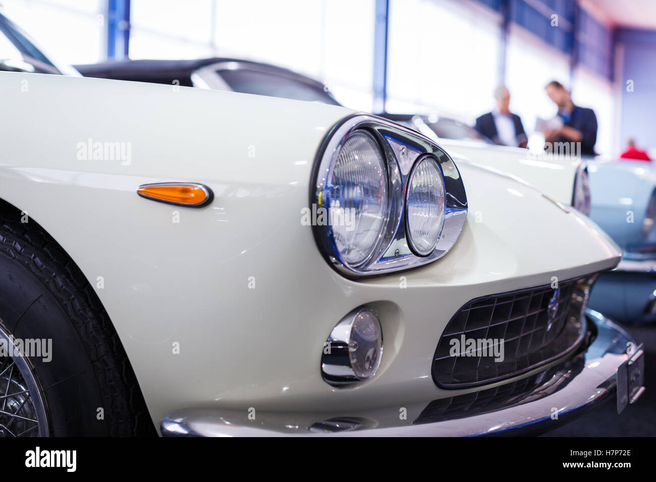 Old cars auction - People viewing cars on sale during an expensive ...
