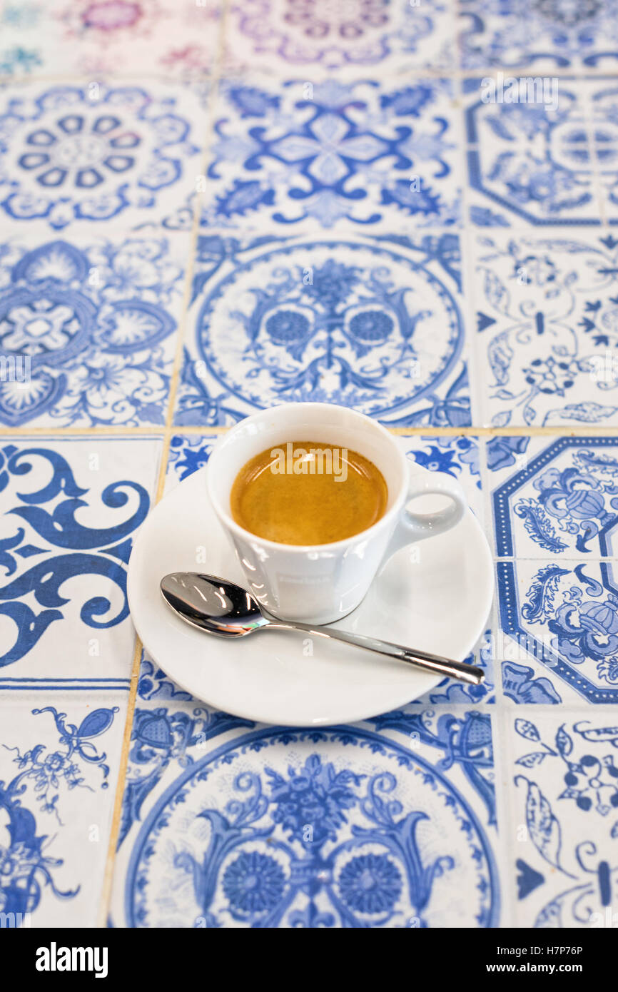 espresso coffee on white and blue tiles - Stock Image