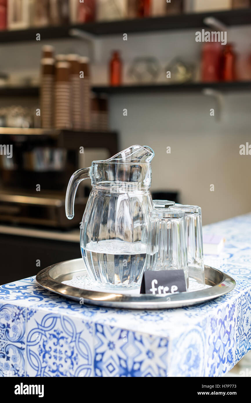 Carafe with free water in cafe. - Stock Image