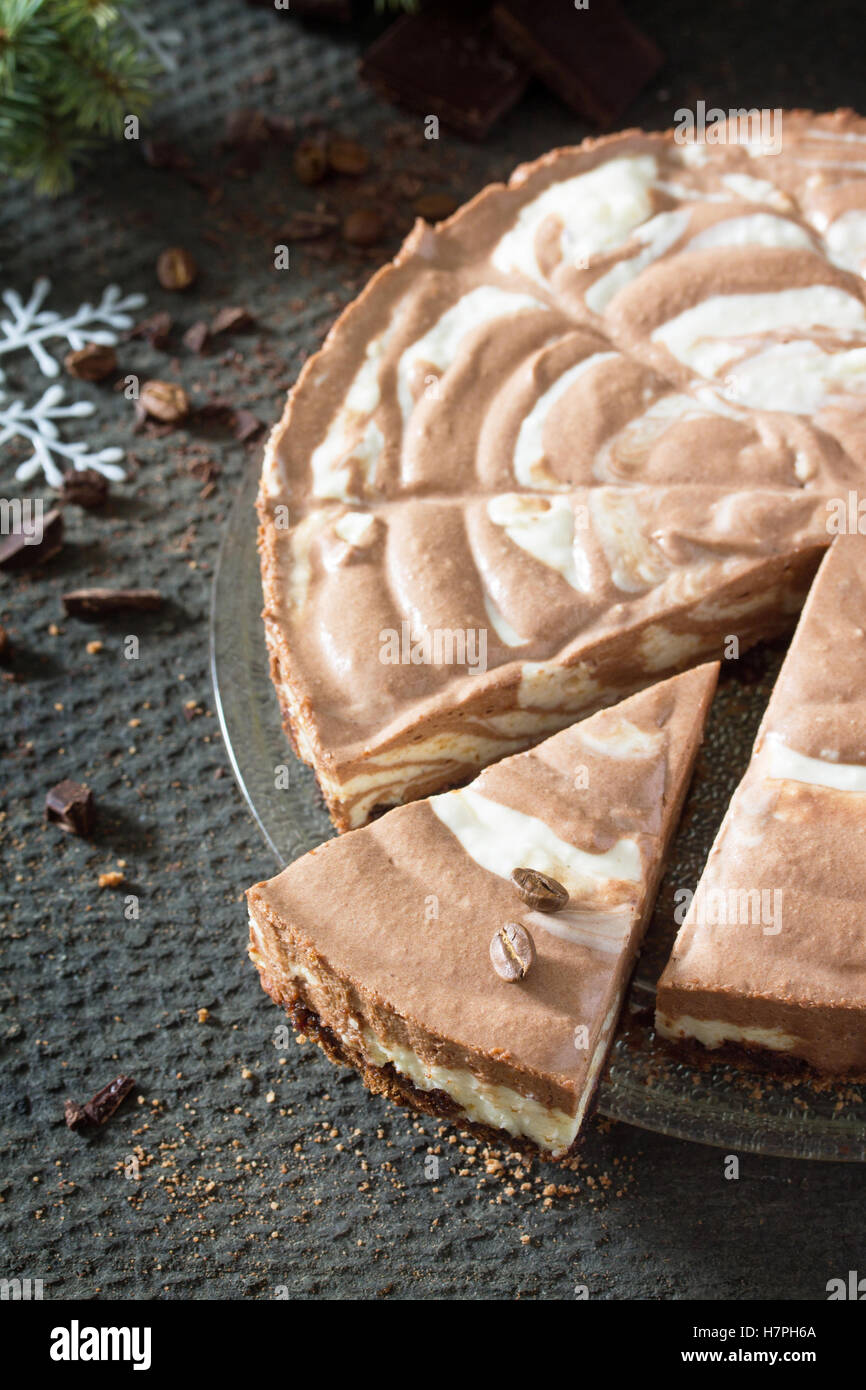 Chocolate ice cream cake Zebra on dark stone background. Christmas tree and decorations. Stock Photo