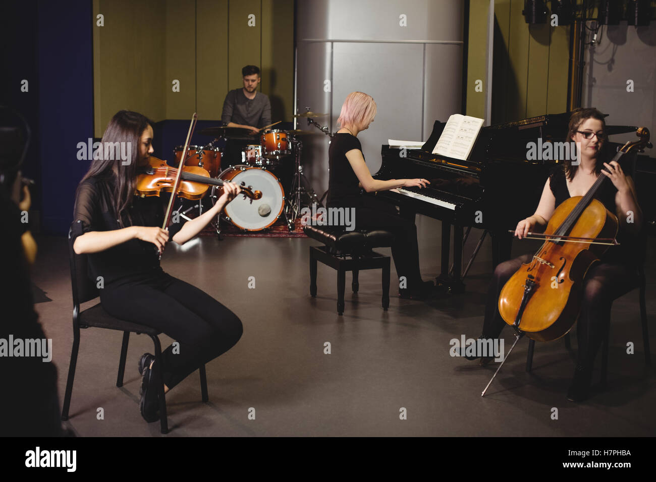 Group of students playing various instruments - Stock Image
