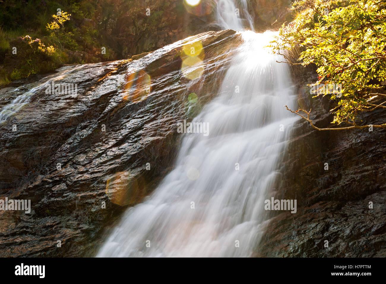Waterfall detail with longtime exposure, Fairy Pools, Isle Of Skye, Hebrides. Lensflares. - Stock Image