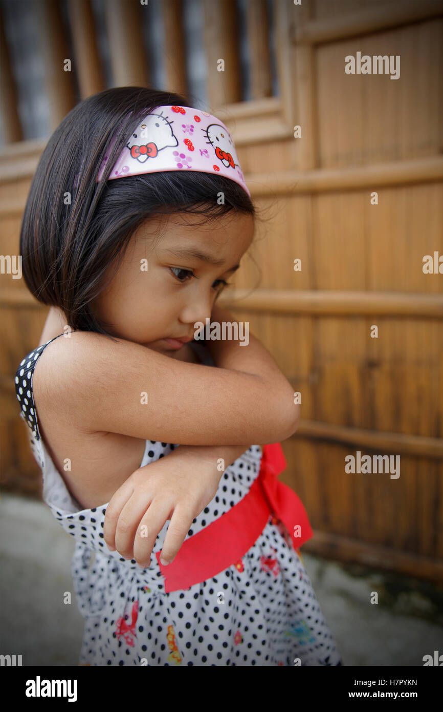 SIPALAY,PHILIPPINES-OCTOBER 13,2016: Little girl wears her best dress to go to church on October 13, Sipalay,Philippines. - Stock Image