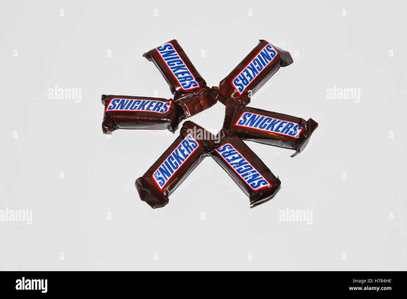 Six mini Snickers chocolate bars isolated on white background. - Stock Image