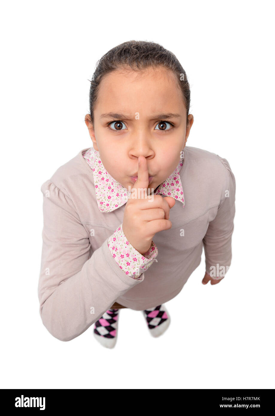 Young Girl with Silence Sign Isolated on White Background - Stock Image