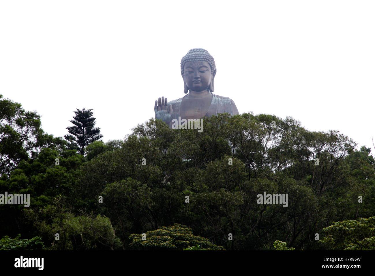 Giant Buddha in mist Po Lin Monastery, Hong Kong, China - Stock Image