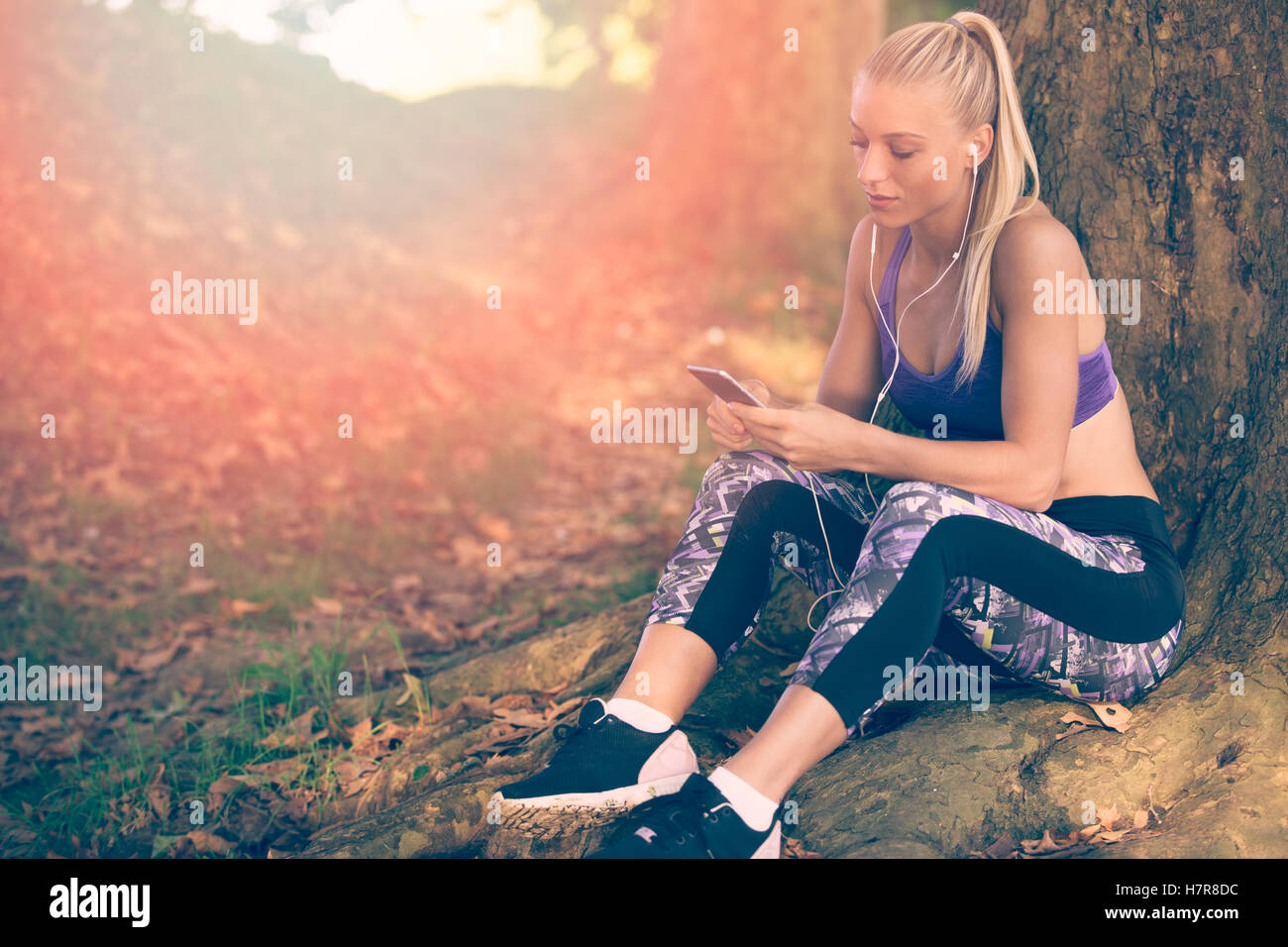 Breathing deep during jogging in the forest - Stock Image