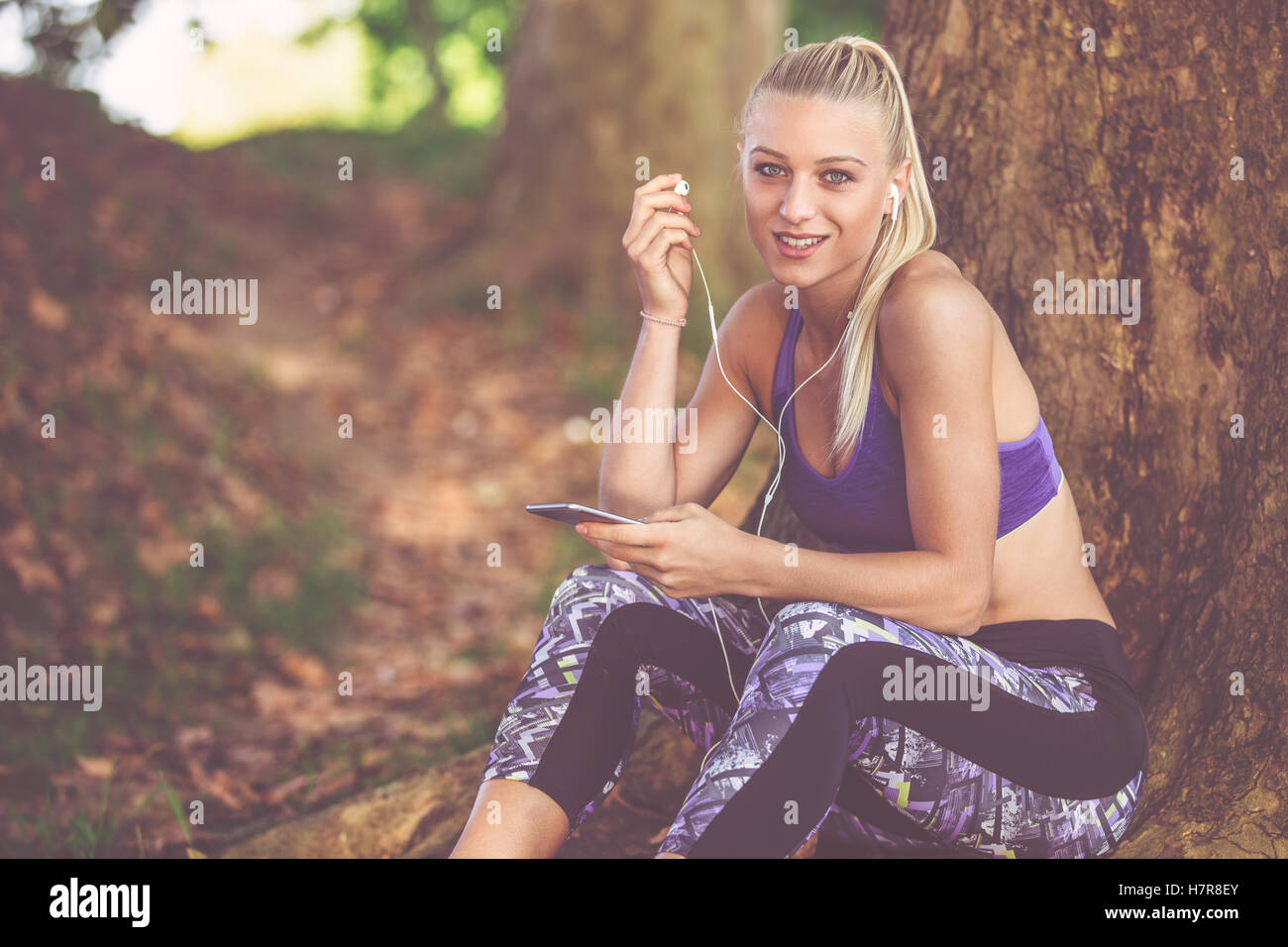 Breathing deep during jogging in the forest Stock Photo