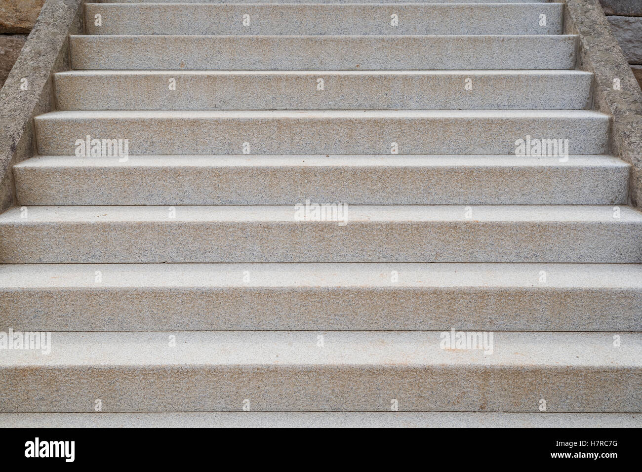 Granite stone stairs viewed from the front. - Stock Image