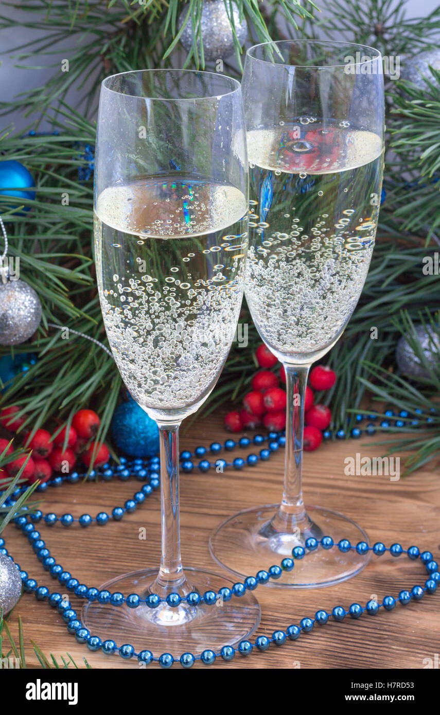 Christmas and New Year still life composition with two champaign glasses, pine tree acerose, red rowan berries, - Stock Image