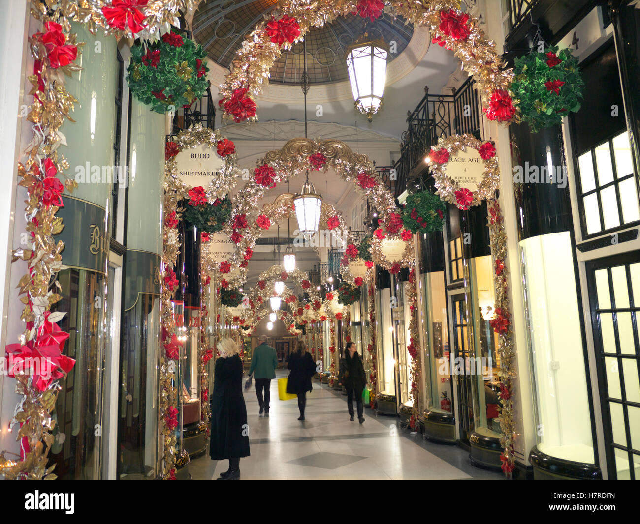 The Piccadilly Arcade with traditional festive decorations and Christmas shoppers Piccadilly  London UK - Stock Image