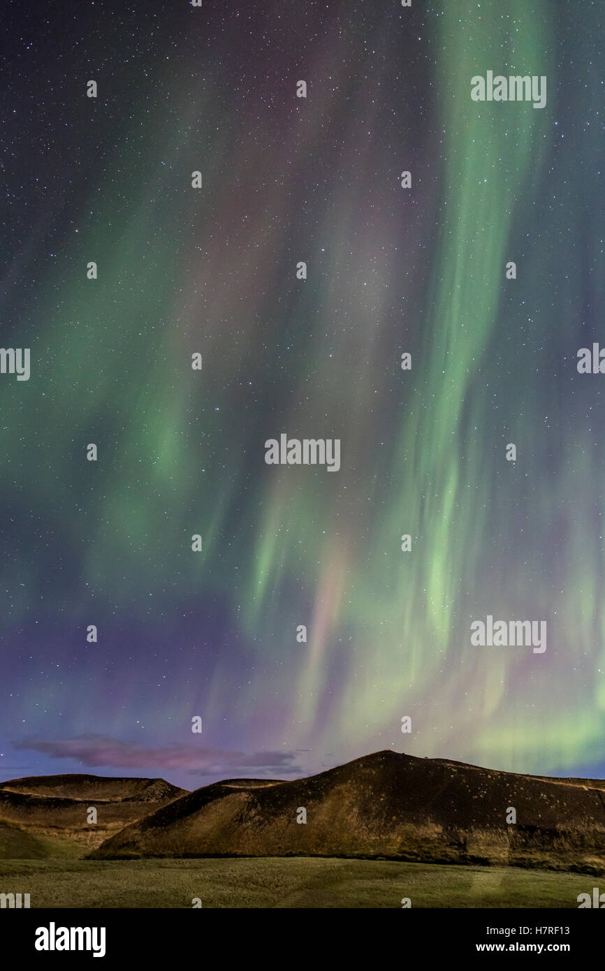Breathtaking Aurora borealis over pseudocrater in Myvatn Iceland - Stock Image