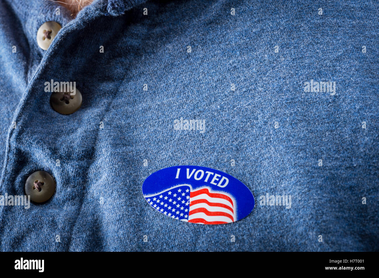 Detail of I Voted sticker on man's chest - Stock Image
