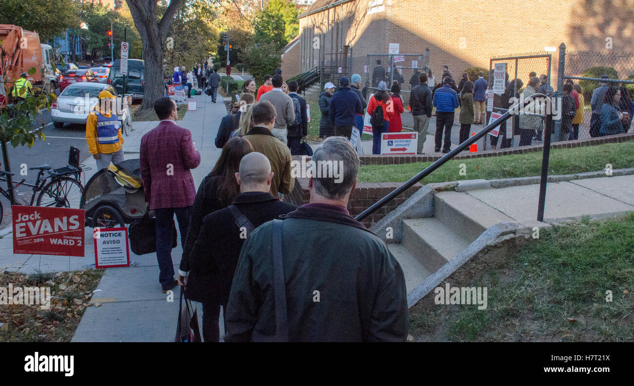 Election Day 2016, Washington, DC. Voters approach the entrance to their polling place, in the basement of a local - Stock Image