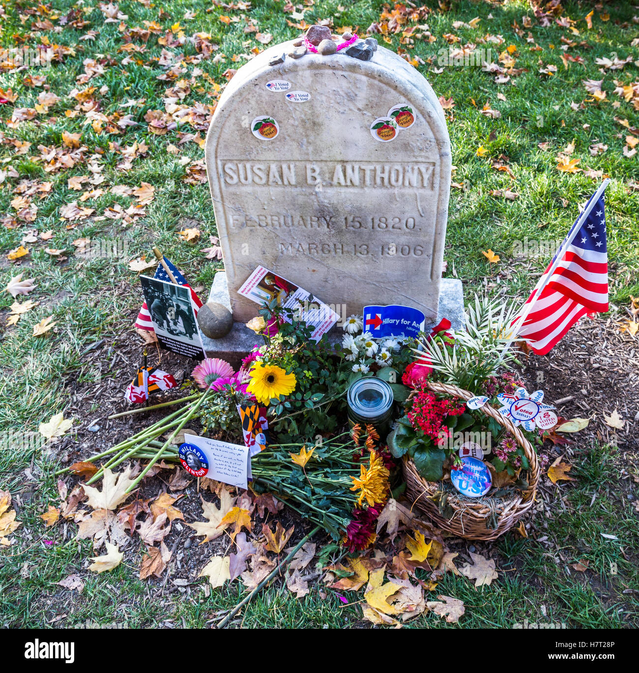 Susan B. Anthony women rights leader gravestone covered with 2016 USA presidential election stickers, personal notes, - Stock Image