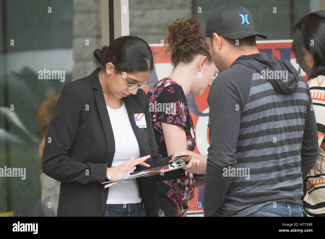 Election workers check the identification of voters at a south Austin polling site during Nov. 8 presidential election. Stock Photo
